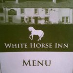 Menu cover showing front view of the Inn
