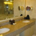 Enormous bathroom with double sinks and ceiling speakers