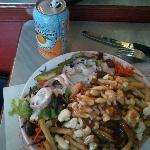 Poutine, Salad, and Orange drink