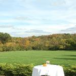 Quaint outdoor seating with a view for wedding reception
