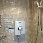 The small bathroom, but the shower functioned well with hot water