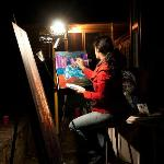 Live painting during our summer concert series, Art After Dark