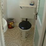 Original vintage fixtures and tile in each sparkling-clean bathroom.