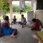 Kids playing 5 Stones