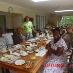 My family enjoying breakfast with other guest. Delia (in green T-shirt) overlooking