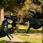 Sculptures line the walking path, including this dramatic one of police dogs.