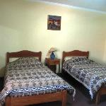 My friends' room which had four beds in it. Nice woven bedspreads and thick blankets
