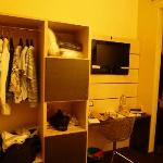 Closet unit and TV, safe and stocked bar fridge