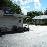 Freshly sealed driveway makes the motel shine.