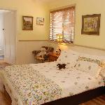bedroom with wenetex bed in garden suite