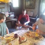 Innkeeper Jason playing mountain dulcimer at breakfast