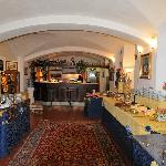 Breakfast room with vast variety of hot and cold food; fruits, coffee, cappuccino, teas, breads