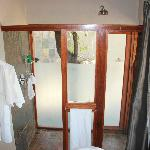 Indoor and outdoor showers connected by a door
