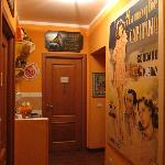 Kitchenette, vintage posters and the door to my room