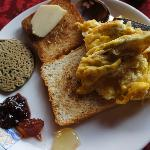 Breakfast - organic wild strawberry and plum jam, buckwheat pancakes and fried omelette