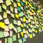 The post-it wall where you can leave your testimonial