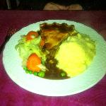 Steak & kidney pie with mashed potatoes and vegetables