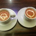 compliments of the chef on our anniversary. espresso cups of tomato soup decorated with love hea