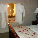 cozy warm robes border the opening to the jetted jacuzzi bath