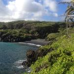 view of the black sand beach .. camp ground is the grassy area on the hill to the left