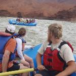 Our River Guide sits center on the raft, rowing and navigating.