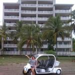Our friend with her electric car in front of the Palms.