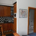 Inside studio; kitchenette; door to small bathroom