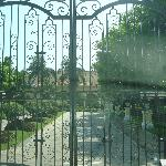 The beautiful scrolled iron gates entrance