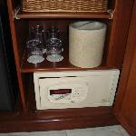 The safe, ice bucket and galsses in room