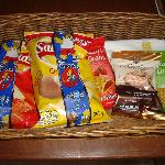 Snack basket replenished daily in room..