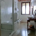 Bathroom of the room with bathtub and shower