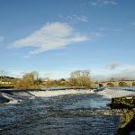 Looking North up the River Nore at the weir and thd bridge in Bennettsbridge.