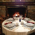 Dinner table in front of fire in dining room