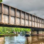 Railway bridge goes over the canal