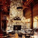 Lobby and dining room features a floor to ceiling river rock fireplace