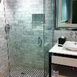 bathroom with custom stall shower
