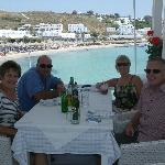 Dining with friends in casual restaurant overlooking sea/beach.