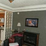 flat screen tv above fireplace