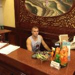 James working the front desk
