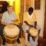 Ian and Ronald Raymond McDonald Garifuna drumming on the porch of Charlie's Bar