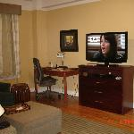 check out the small tv. beautiful wooden floors