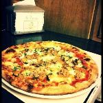 customized pizza by one of our customers. Tomato-sauce,mozzarella,shrimps,tuna & grilled zucchin
