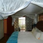 Bedroom, with doors leeding onto balcony
