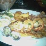 Seafood Platter which included a fillet of fish, bbq prawns, oysters and squid with fresh chips.