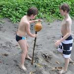 Hulling coconuts on a walk
