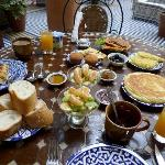 The lavish breakfast served in the beautiful courtyard