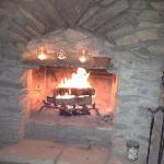 Relaxing by the fire....separate room from cabin
