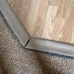 worn and poorly installed floor molding...