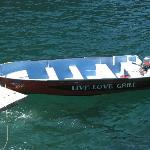 LIVE. LOVE. GRILL. (on the side of his boat)