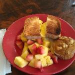 Breakfast Sandwich with fruit and mango muffin.